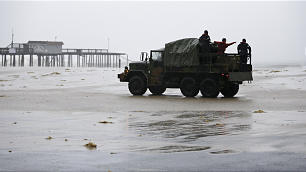 First responders in military truck check the area parking lot near the Ocean City Fishing Pier as Hurricane Sandy bears down on the East Coast, Monday, Oct. 29, 2012, in Ocean City, Md.