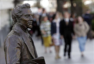 A statue of Joseph Smith stands on the Main Street Plaza as people make their way to the Conference Center to attend the Sunday morning session of the 176th annual general conference of the Church of Jesus Christ of Latter-day Saints in Salt Lake City, Utah April 2, 2006. Photo by Keith Johnson/Deseret Morning News 176th annual.