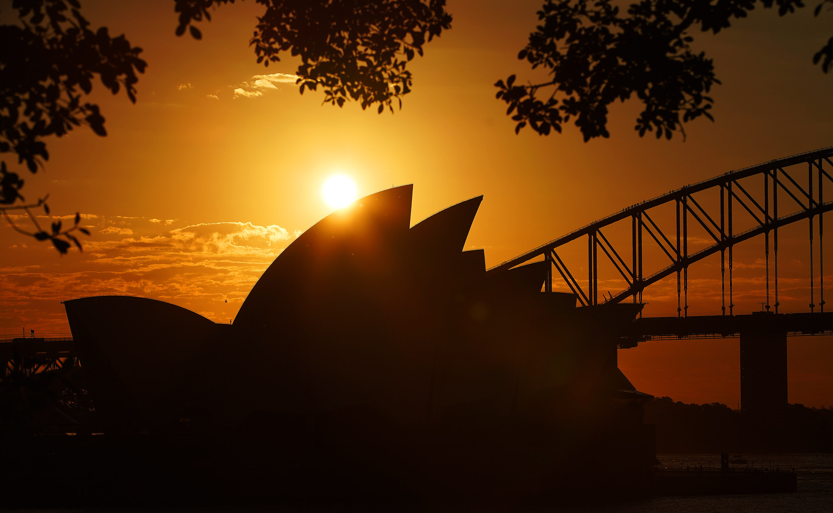 The iconic Sydney Harbor Bridge and Sydney Opera House are highlighted by the evening sunset on May 17, 2019 in Sydney, Australia. President Russell M. Nelson, with his wife Sister Wendy Nelson, will visit the city on his nine-day, seven-nation Pacific Ministry Tour.