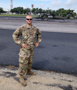 Army Captain A.J. Edwards stands near a military airstrip. The lifelong member was struck by lightning 20 years ago and utilized resilience and faith to recover from his injuries.