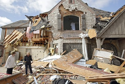 Hazel Wright and her daughter Karen Arms, from left, try to find a spot to begin on the damage clean up at Arms' home in the Oaktree addition on Wednesday, Feb. 11, 2009, after a tornado hit the area on Tuesday in Edmond, Okla.