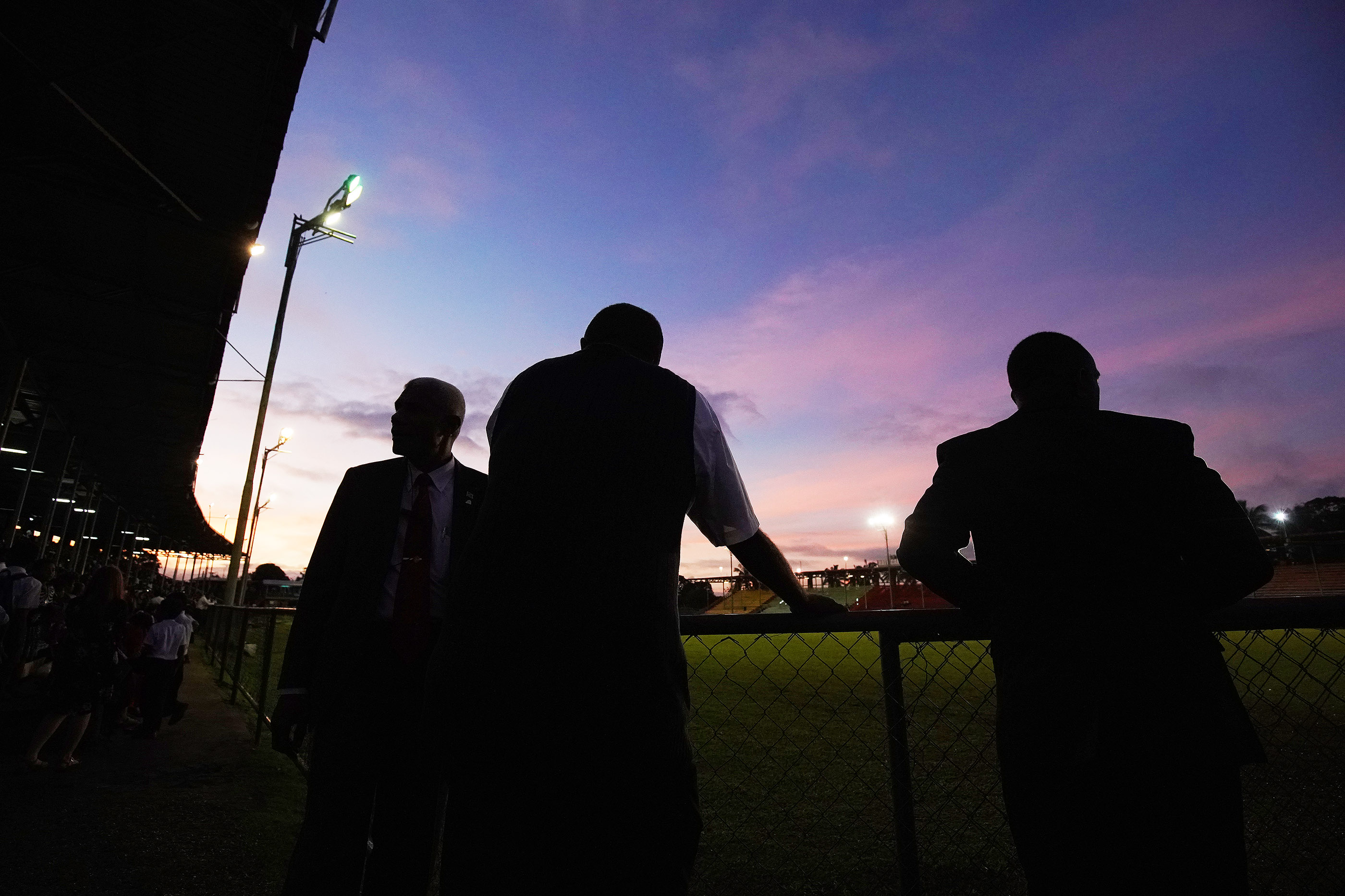 Attendees listen as the sun sets during a devotional at Ratu Cakobau stadium in Nausori, Fiji on May 22, 2019.
