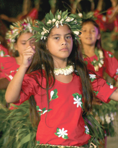 A young woman dances with others at the Friday evening program held in the To'ata amphitheater on the Papeete wharf.