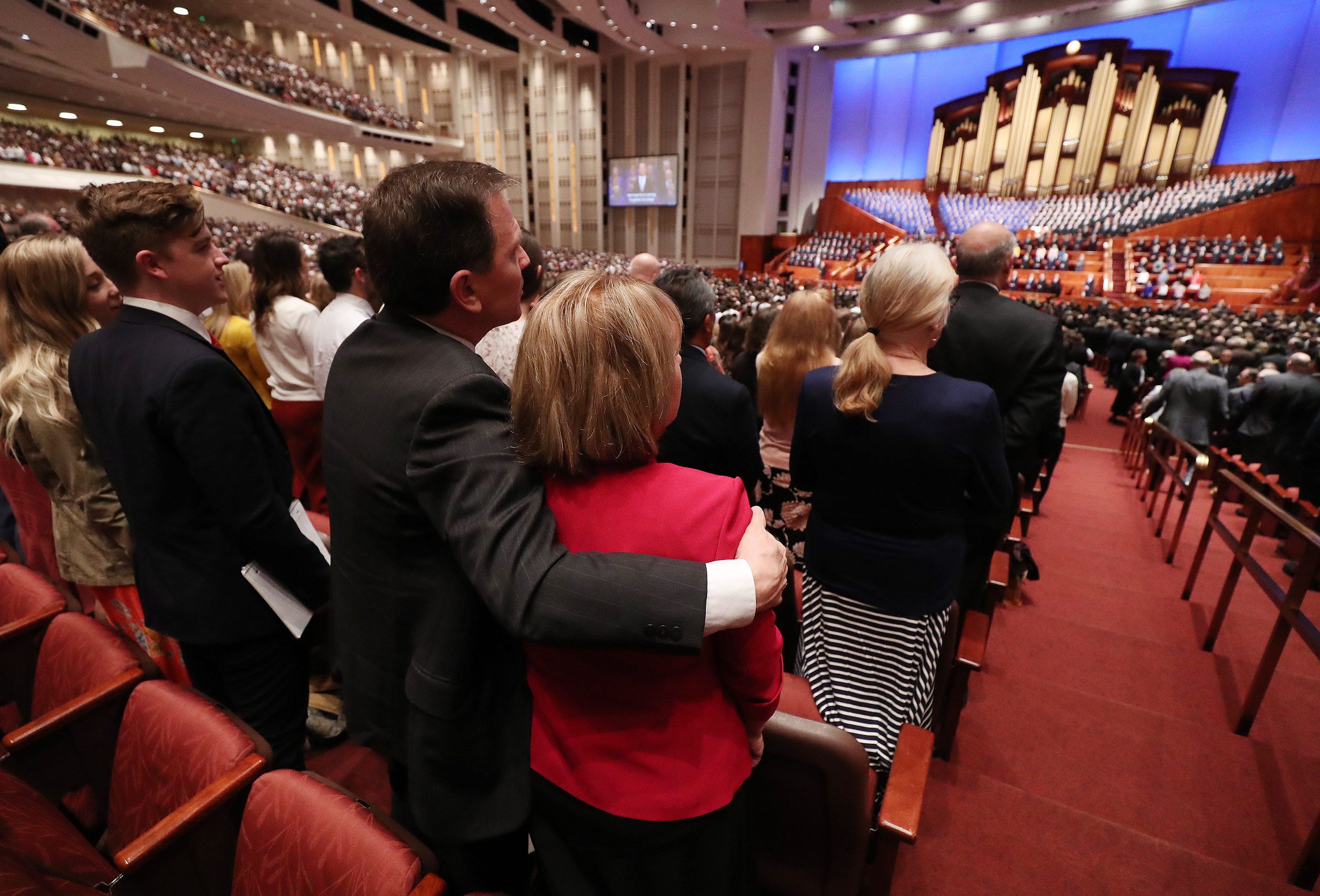 Attendees sing a congregational hymn during the 189th Annual General Conference of The Church of Jesus Christ of Latter-day Saints in Salt Lake City on Saturday, April 6, 2019.