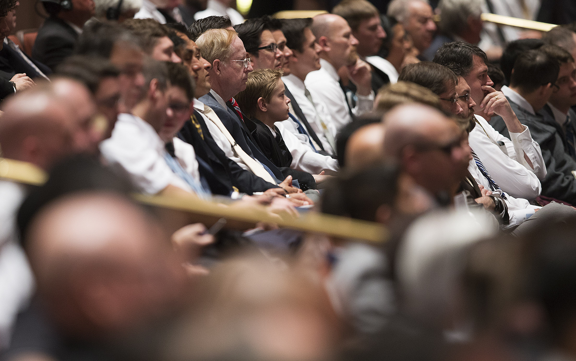 Audience members listen during the General Priesthood session of the 188th Annual General Conference of The Church of Jesus Christ of Latter-day Saints, in the Conference Center in Salt Lake City on Saturday, March 31, 2018.