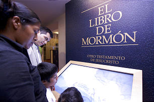 Family enjoys an interactive Book of Mormon exhibit at the Mexico City Temple Visitors Center.