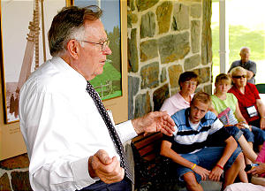 Elder Fred Weibell welcomes a new group of visitors to the Joseph Smith Birthplace Memorial where he recounts the history of the Smith family and testifies of Joseph Smith who was born here.