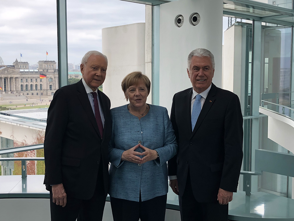 Elder Dieter F. Uchtdorf of the Quorum of the Twelve Apostles and U.S. Sen. Orrin Hatch of Utah meet with German Chancellor Angela Merkel in Germany, Friday, July 6, 2018.