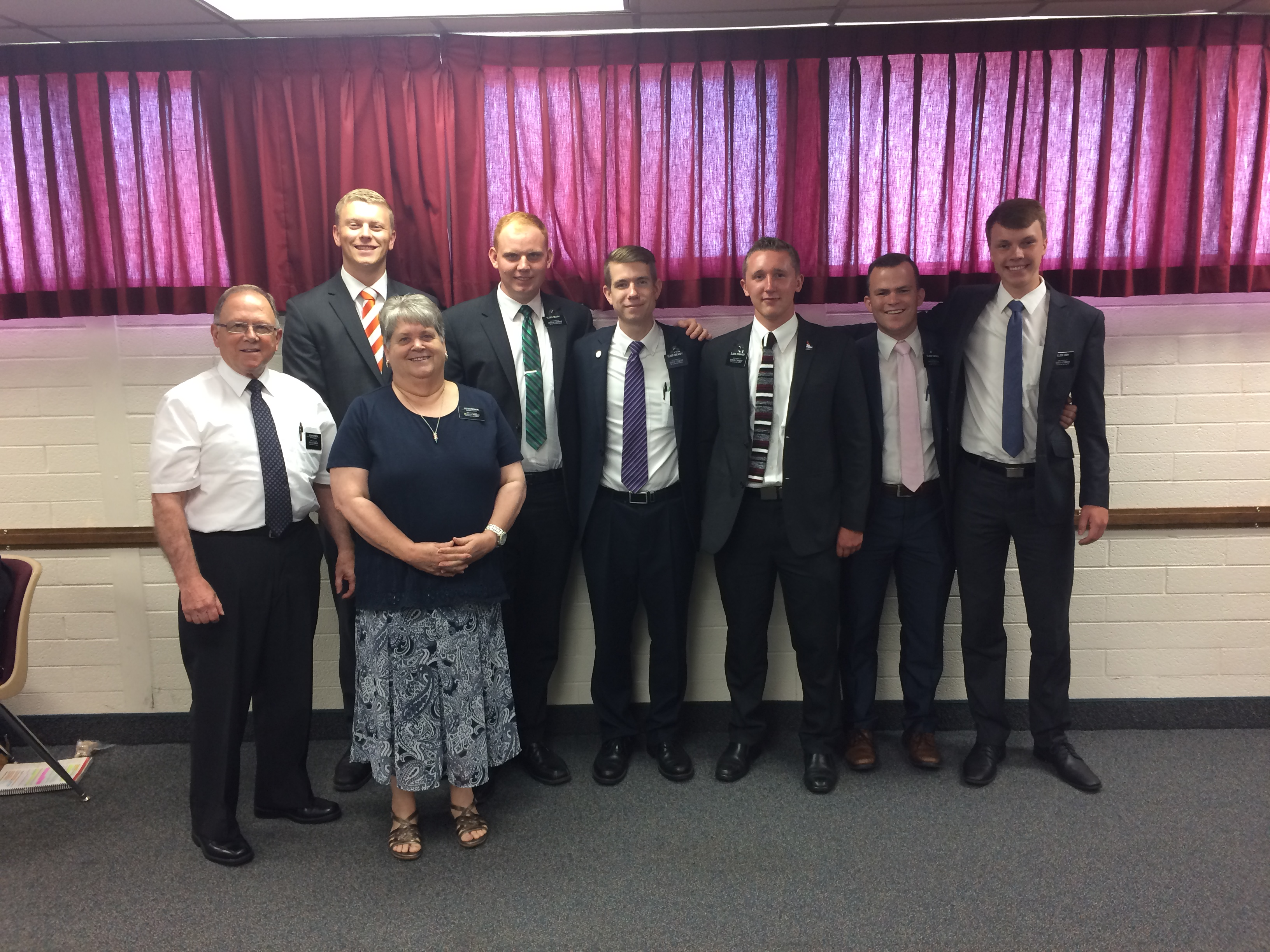 Elder Bruce Bowen and Sister Valerie Bowen, who are serving as self-reliance missionaries in the Tennessee Knoxville Mission, stand with a district of young elder missionaries after a district meeting.