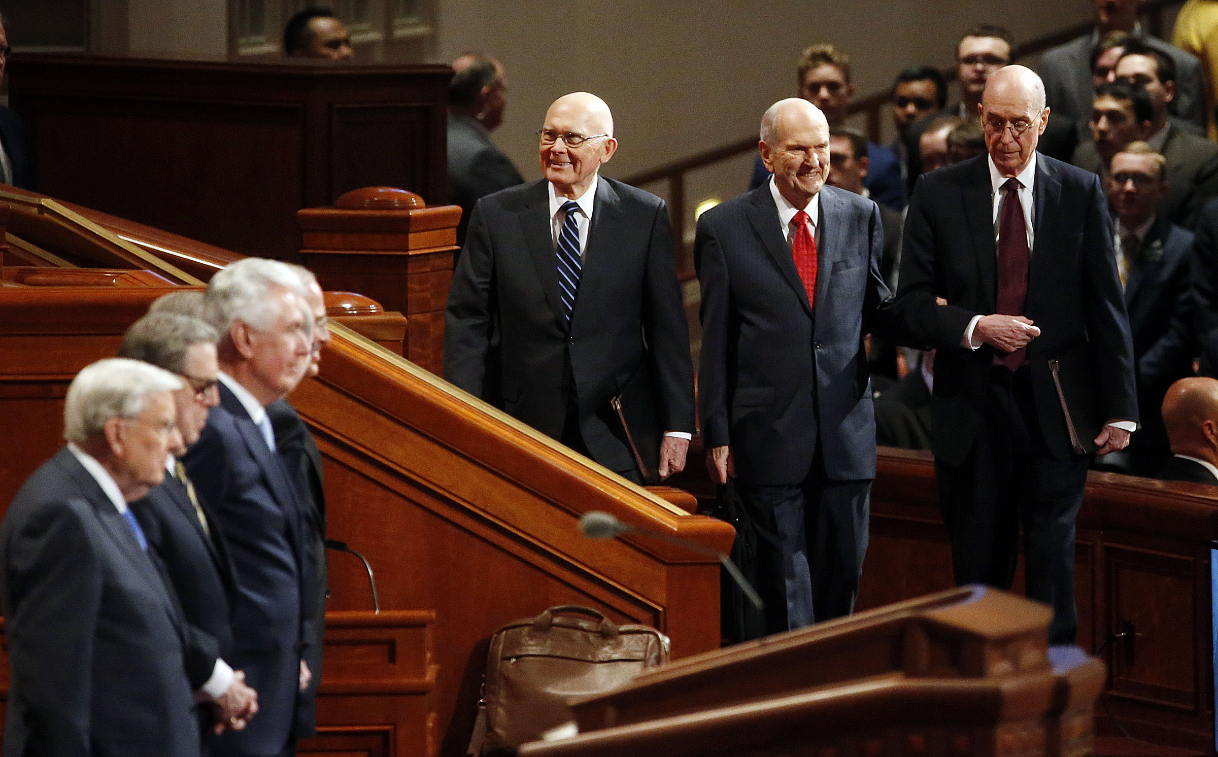 President Russell M. Nelson of The Church of Jesus Christ of Latter-day Saints, center, and his counselors, President Dallin H. Oaks, first counselor in the First Presidency, left, and President Henry B. Eyring, second counselor in the First Presidency, right, enter the Conference Center for the priesthood session of the 189th Annual General Conference in Salt Lake City on Saturday, April 6, 2019.