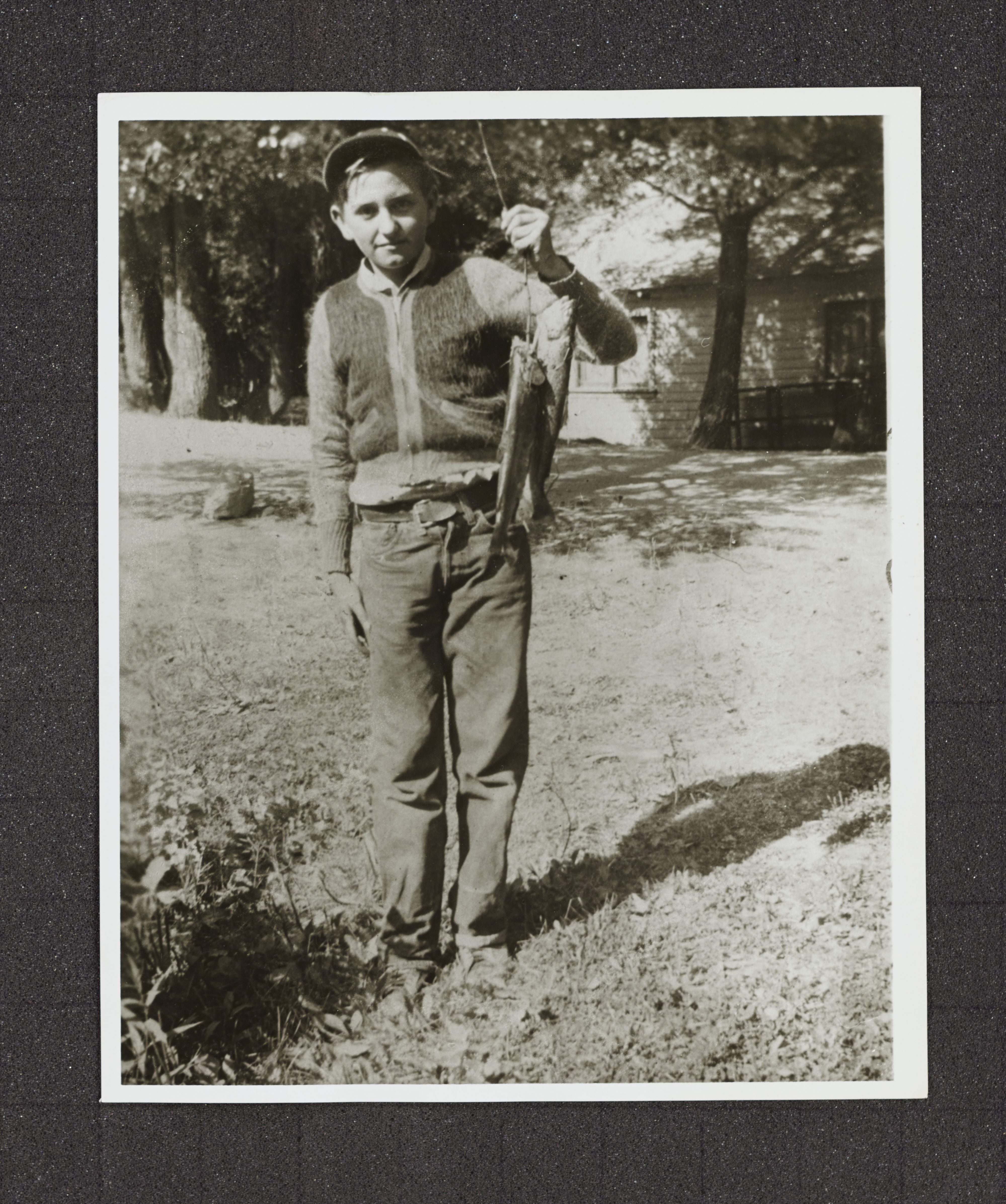 In an undated photo, Thomas S. Monson is photographed having caught two fish at Vivian Park in Provo Canyon.
