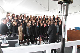 A choir of young single adults performs at the outdoor ceremony for the sealing of the Calgary Alberta Temple's cornerstone.