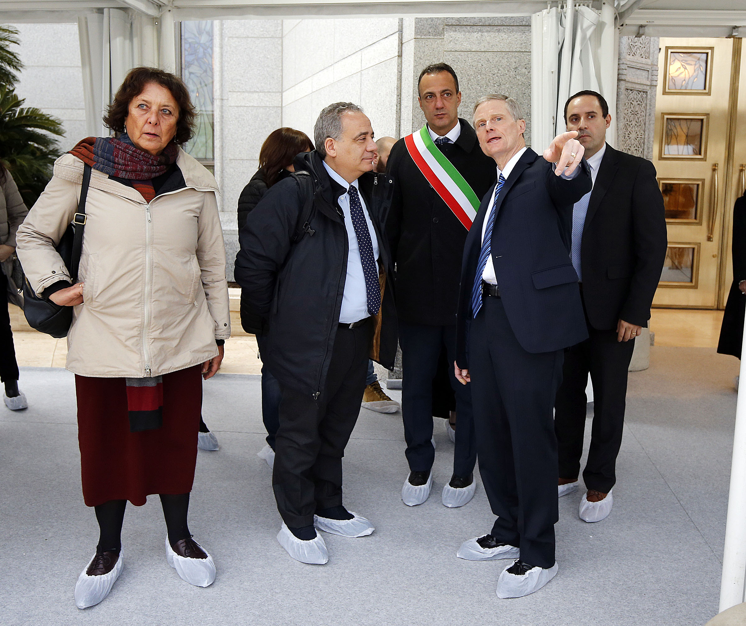 Elder David A. Bednar of the Quorum of the Twelve Apostles of The Church of Jesus Christ of Latter-day Saints talks about features of the Rome Italy Temple grounds on Monday, Jan. 14, 2019. Third from right is President Marcello De Vito of the Rome City Council. Fourth from right is President Giovanni Caudo, president of the Third Municipality of Rome.