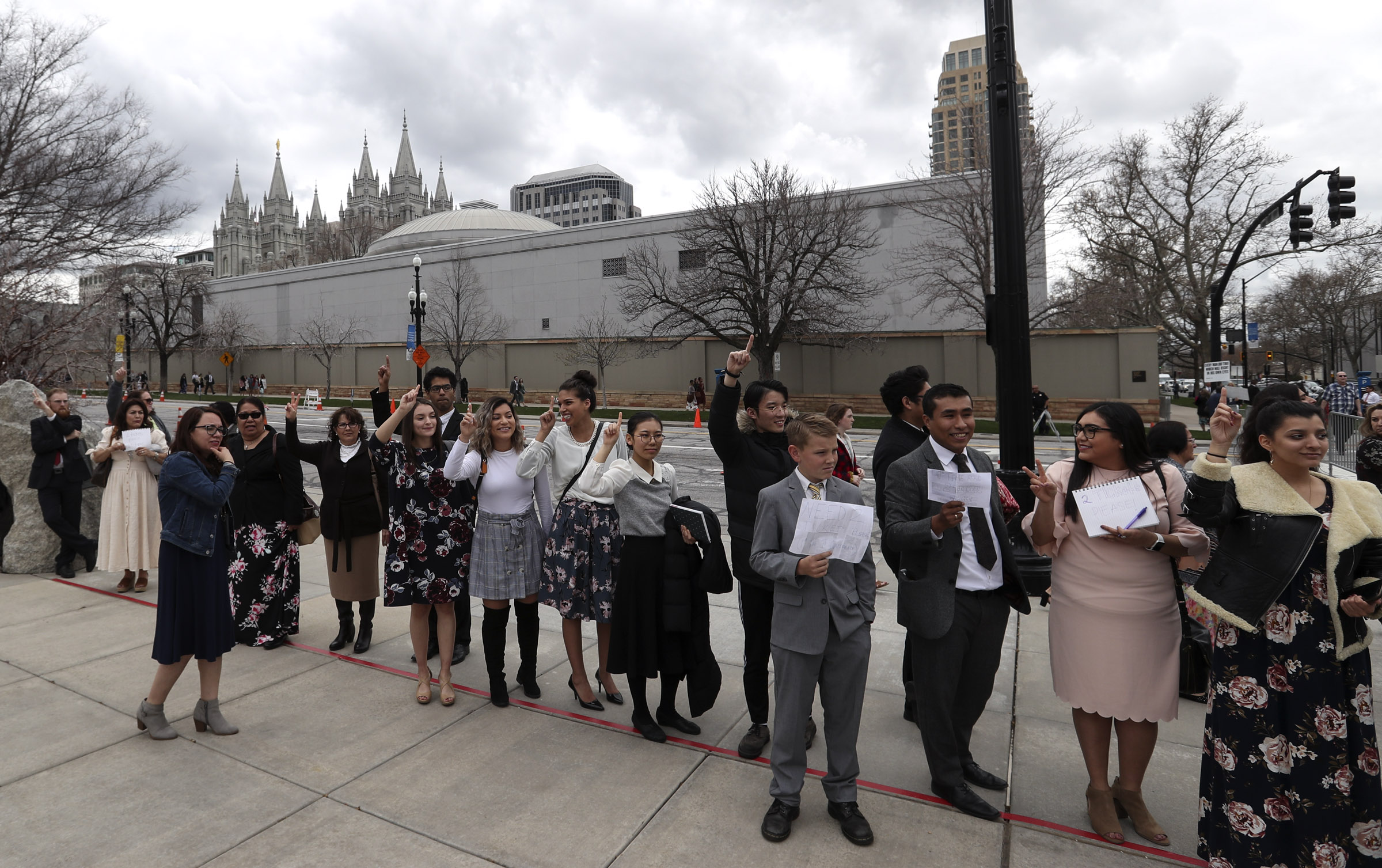 Conferencegoers wait on the sidewalk outside the Conference Center as they try and get tickets to the Saturday afternoon session of the 189th Annual General Conference of The Church of Jesus Christ of Latter-day Saints in Salt Lake City on Saturday, April 6, 2019.