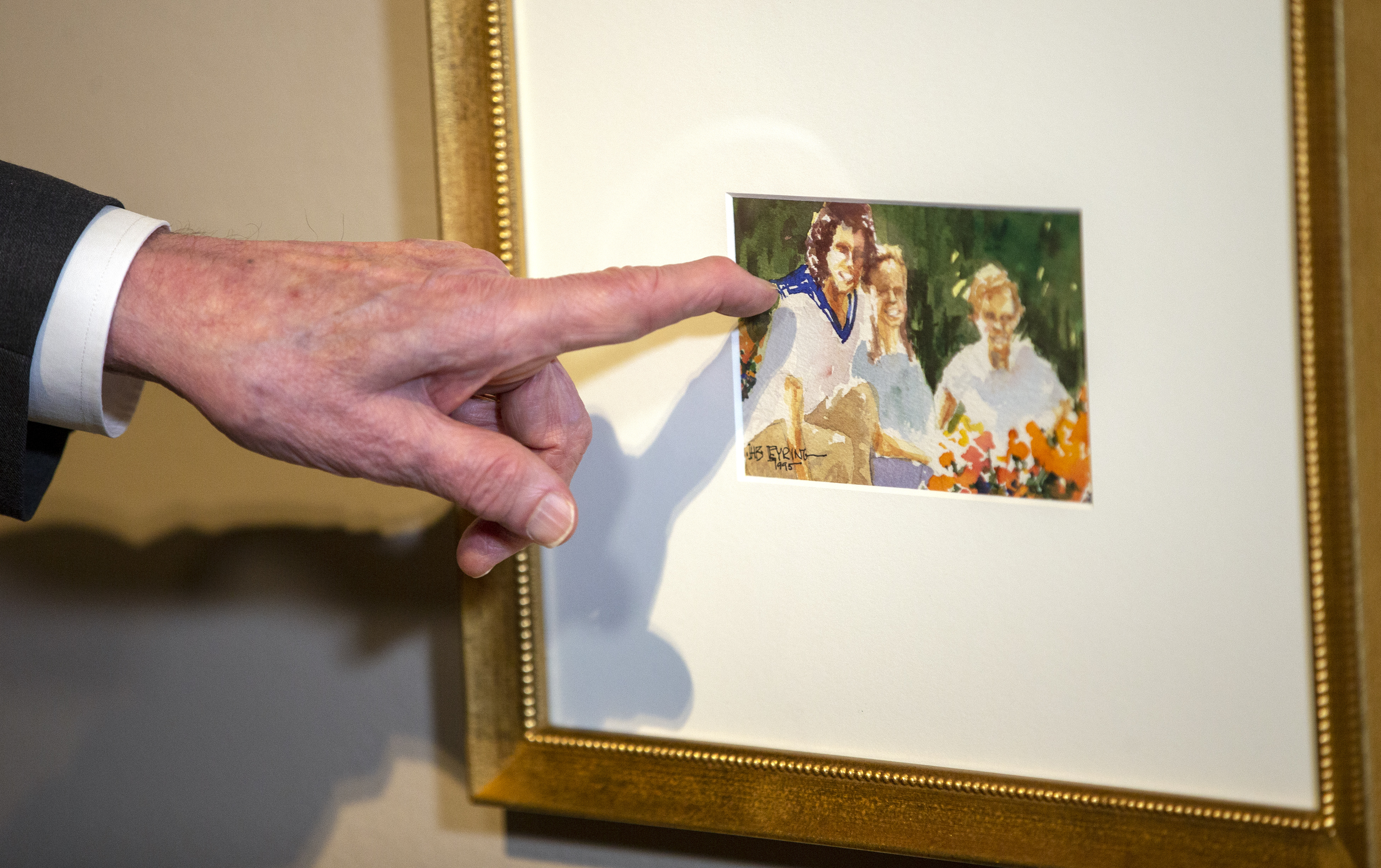 President Henry B. Eyring discusses one of his watercolor paintings on display for a special exhibit at the Church History Museum in Salt Lake City.