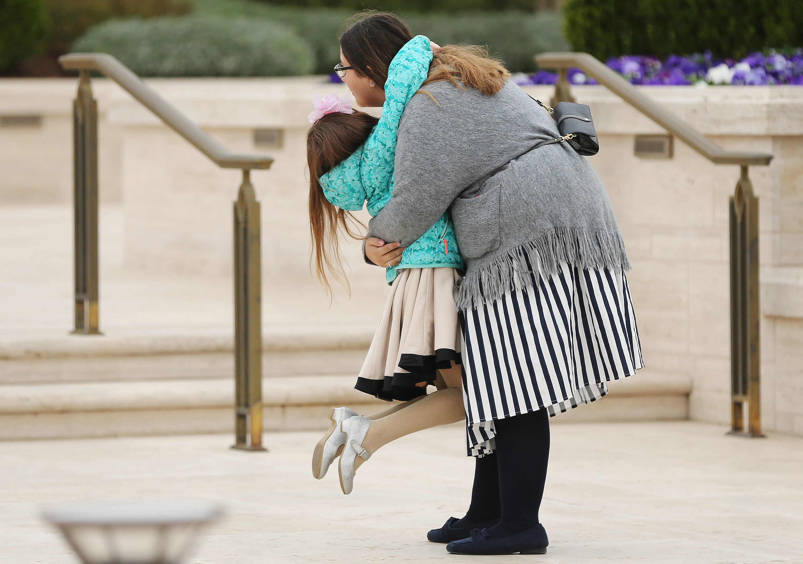 Emma Laura Celestini, left, hugs Eleonora Caravella outside the Rome Italy Temple during the building's first dedicatory session on Sunday, March 10, 2019.