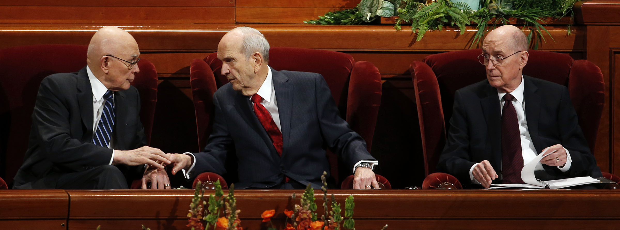 President Russell M. Nelson of The Church of Jesus Christ of Latter-day Saints, center, and his counselors, President Dallin H. Oaks, first counselor in the First Presidency, left, and President Henry B. Eyring, second counselor in the First Presidency, right, confer at the beginning of the Priesthood session of general conference in Salt Lake City on Saturday, April 6, 2019.