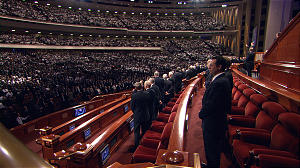 General Authorities join the congregation in singing an intermediate hymn during the priesthood meeting of general conference. The members of the First Presidency were among the speakers in the session.