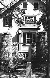 The original lion at Lion House, on portico in early photo.
