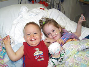 Kendra Herrin plays with her little brother, Austin, who visited Aug. 31. Six days later, Kendra had successful surgery for an intestinal blockage.