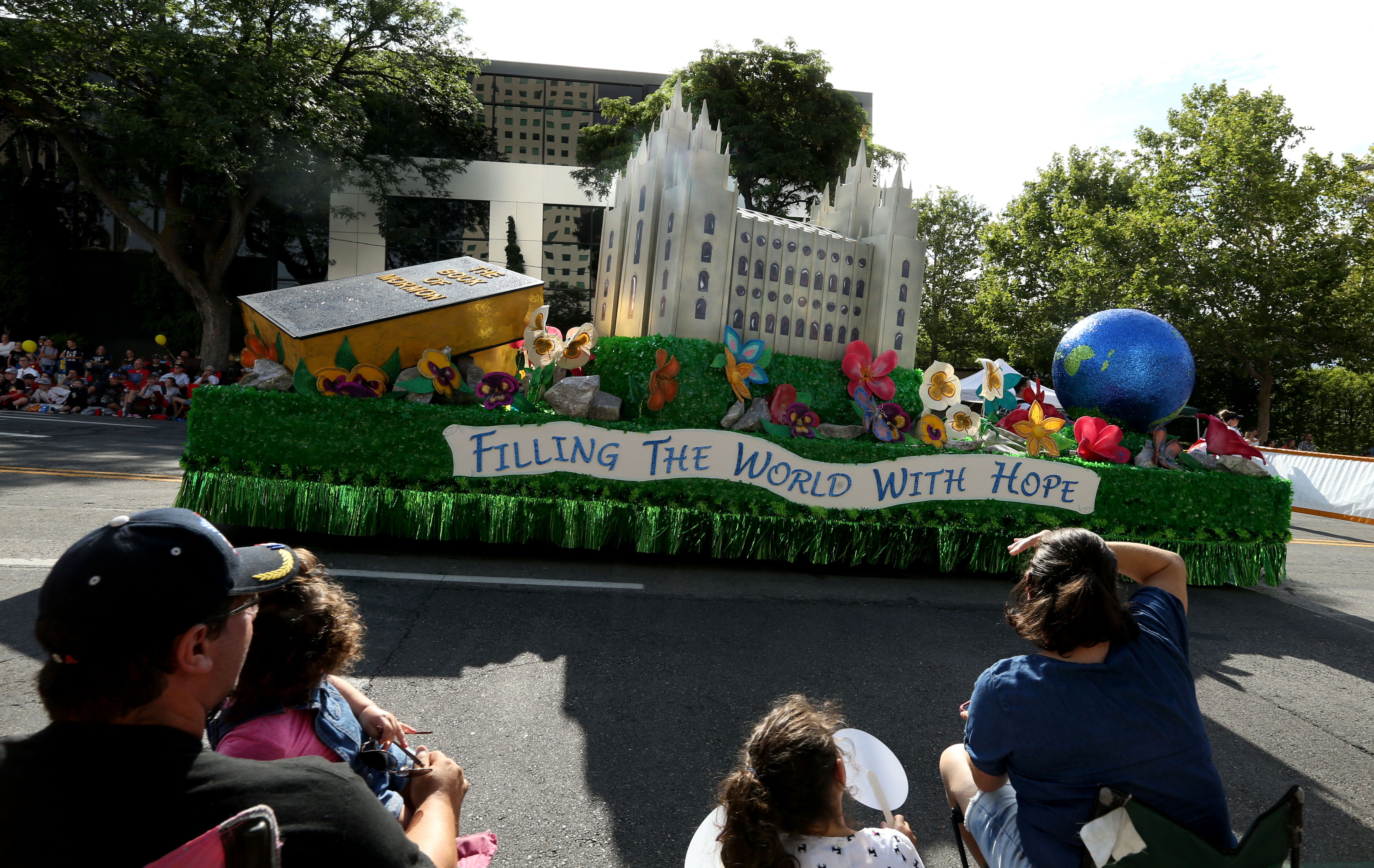 A float decorated with a temple of The Church of Jesus Christ of Latter-day Saints passes by onlookers during the Days of '47 Parade in Salt Lake City on Wednesday, July 24, 2019.