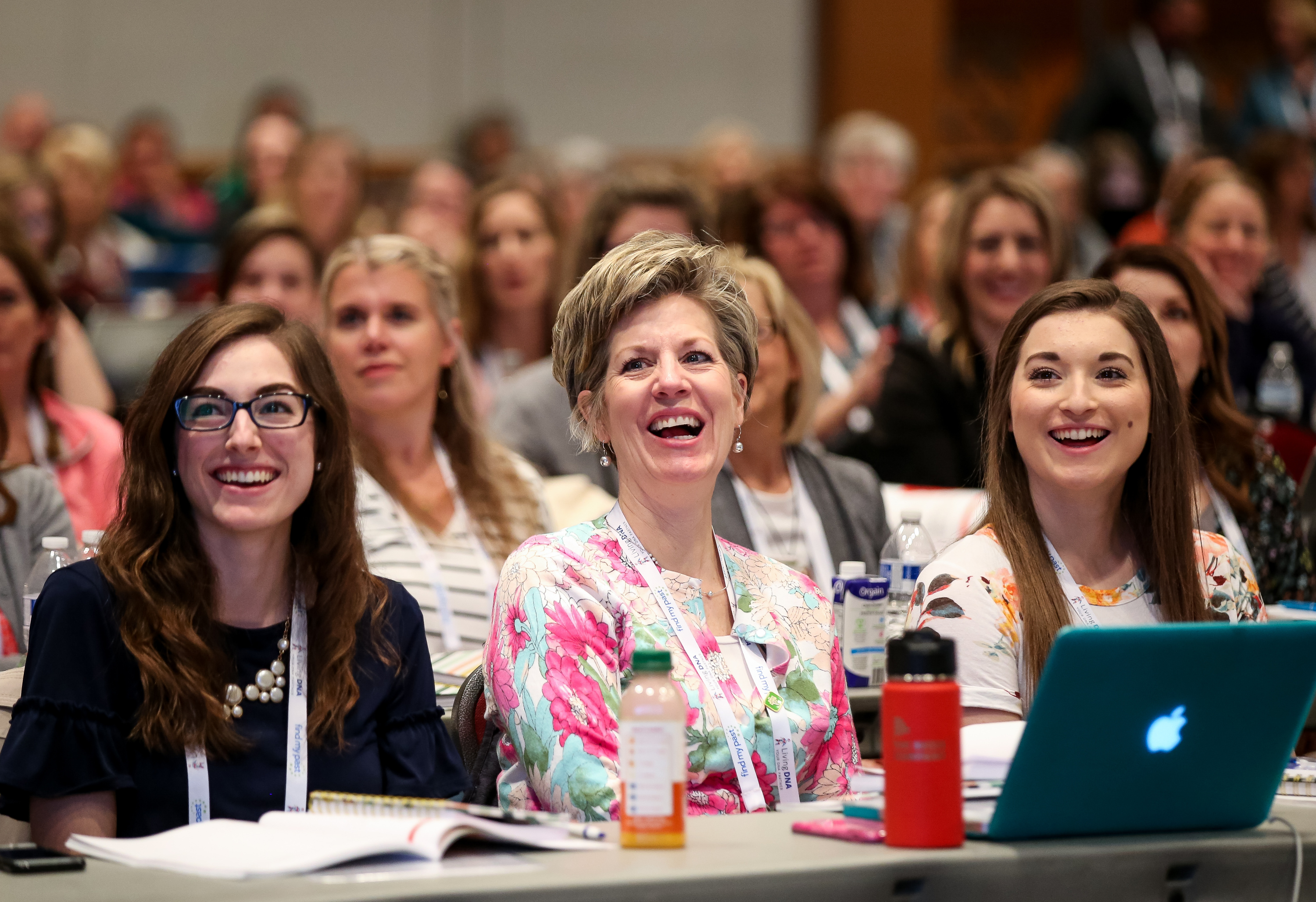 Julie Ilene Koch and her daughters, Mckinsey Koch, left, and Rebecca Koch, right, listen to a speaker during the Light Keepers session at the RootsTech conference at the Salt Palace in Salt Lake City on Friday, March 1, 2019.