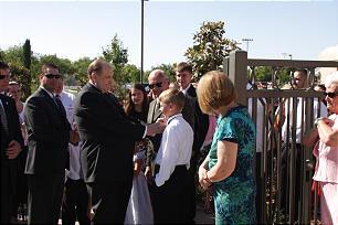 President Thomas S. Monson adjusts 12-year-old Mitchel McHugh's tie before the temple dedication.