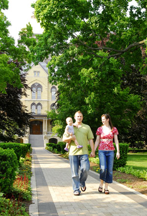 Scott Clark and his wife, Collette, with their daughter, Anya, stroll a tree-lined pathway leading from the famed Basilica on the campus of the University of Notre Dame, South Bend, Ind. Several dozen LDS graduate students find this premier Catholic school to be a good mix of education in a wholesome environment.