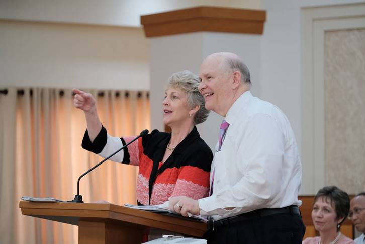 Elder Dale G. Renlund and Sister Ruth Renlund speak at a leaders meeting in the Philippines.