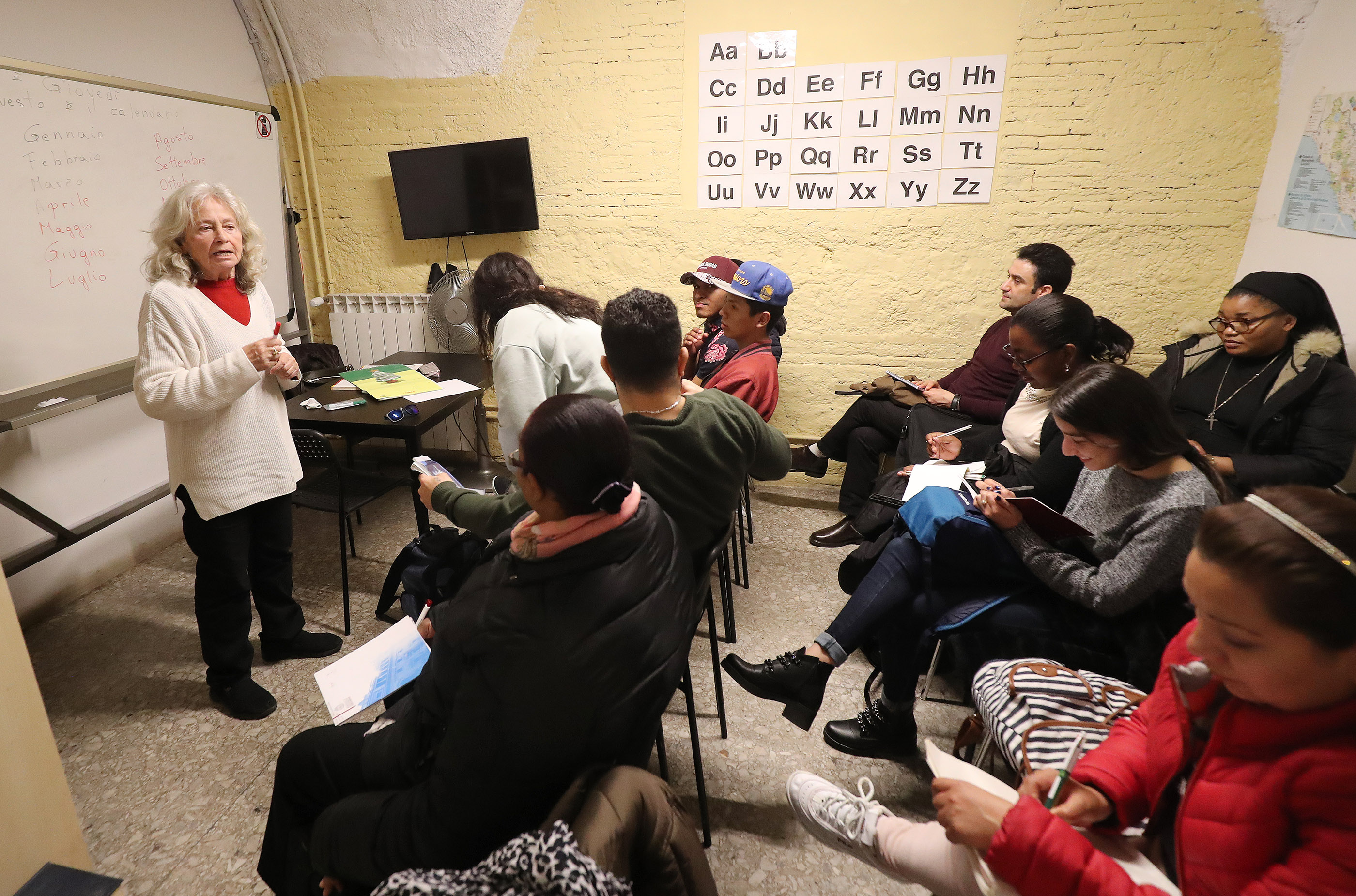 Latter-day Saint volunteer Cecilia Panecianco teaches English language class to refugees at St. Paul's Within the Walls Episcopal Church in Rome, Italy on Thursday, March 7, 2019. The Church of Jesus Christ of Latter-day Saints partners with the Catholic church to help refugees.
