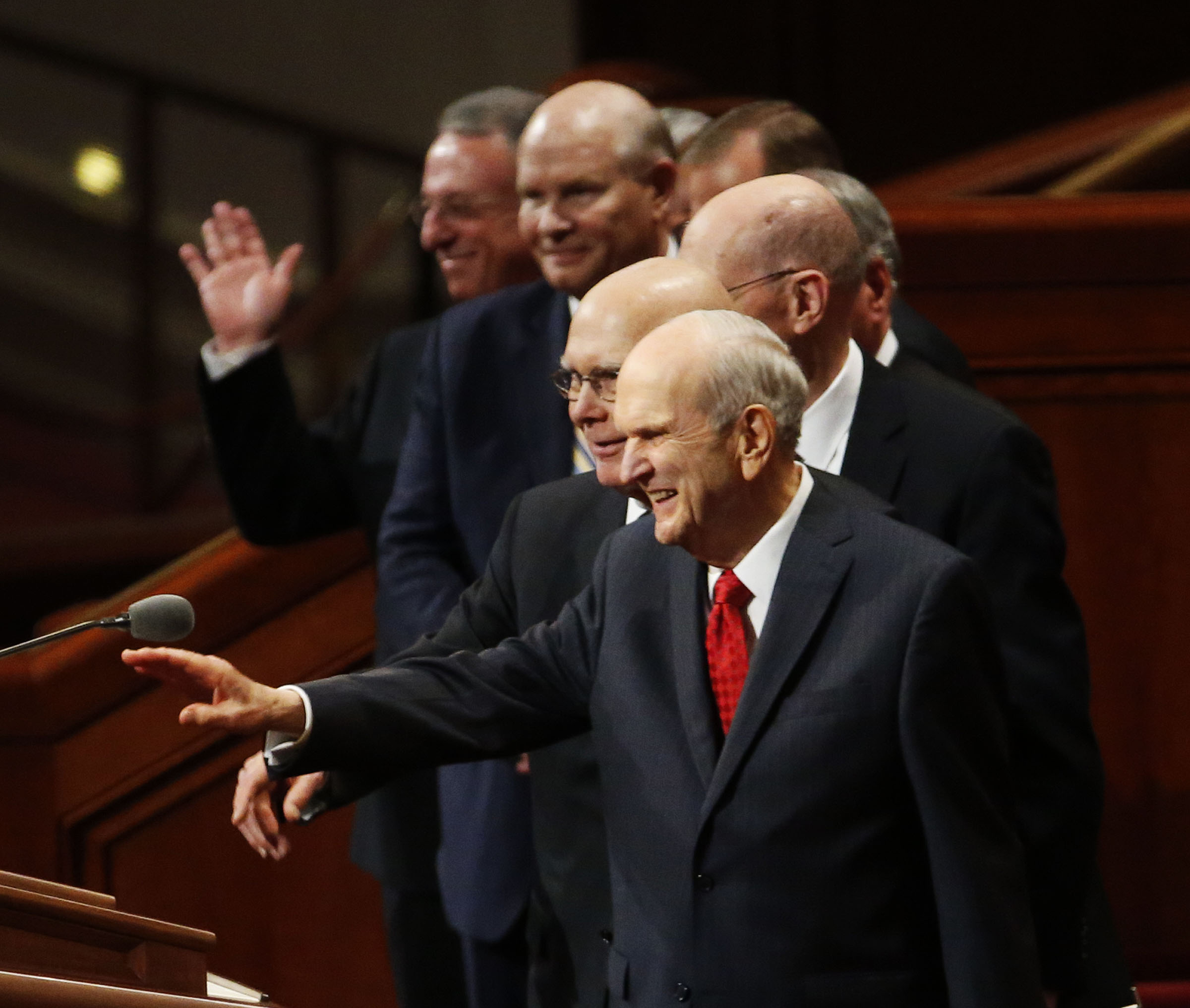 President Russell M. Nelson of The Church of Jesus Christ of Latter-day Saints, front, waves as he and his counselors, President Dallin H. Oaks, first counselor in the First Presidency, and President Henry B. Eyring, second counselor in the First Presidency, leave the Conference Center following the priesthood session of the 189th Annual General Conference in Salt Lake City on Saturday, April 6, 2019.