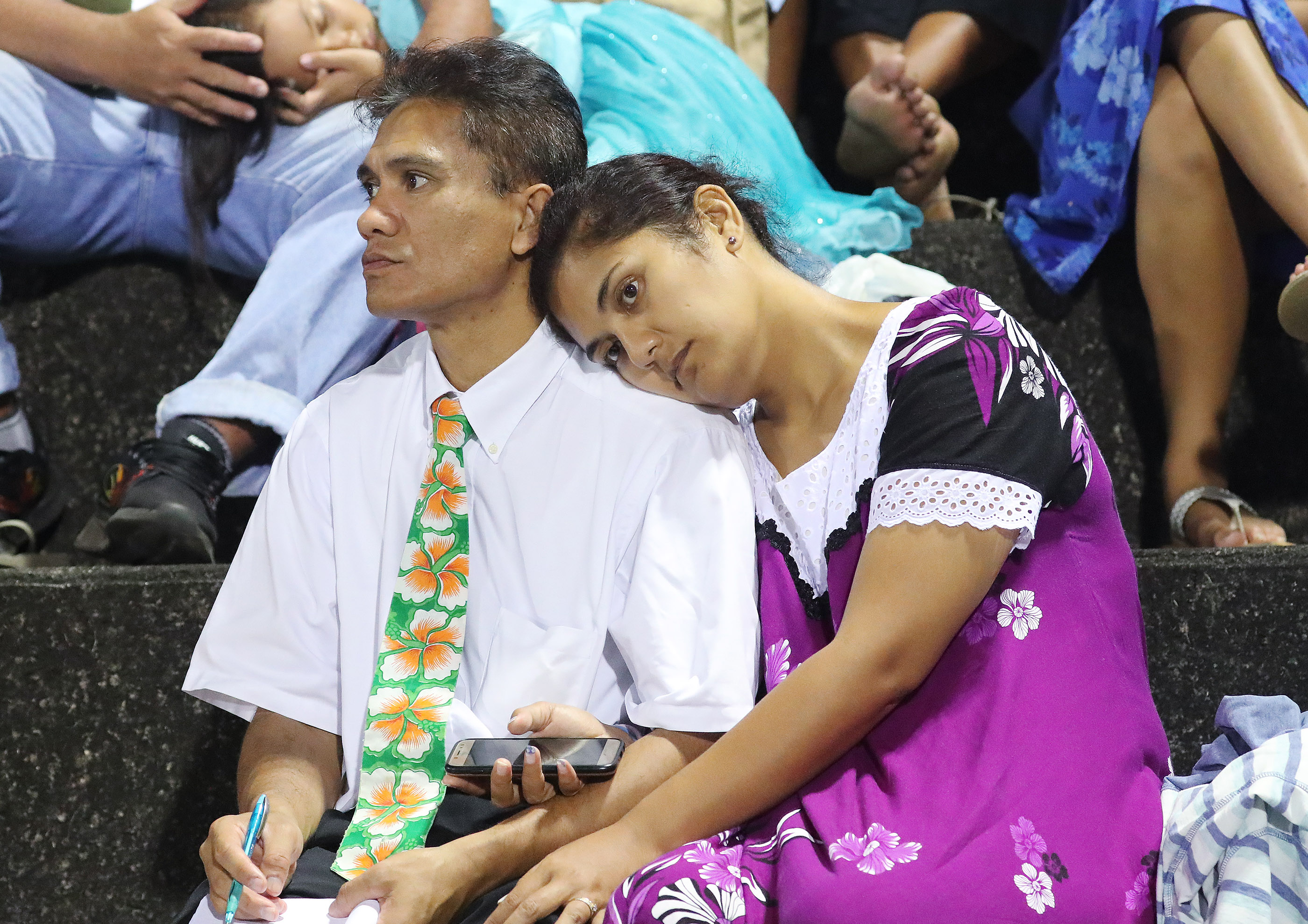 Paul and Tesada Oaoa listen during a devotional in Papeete, Tahiti, on May 24, 2019.