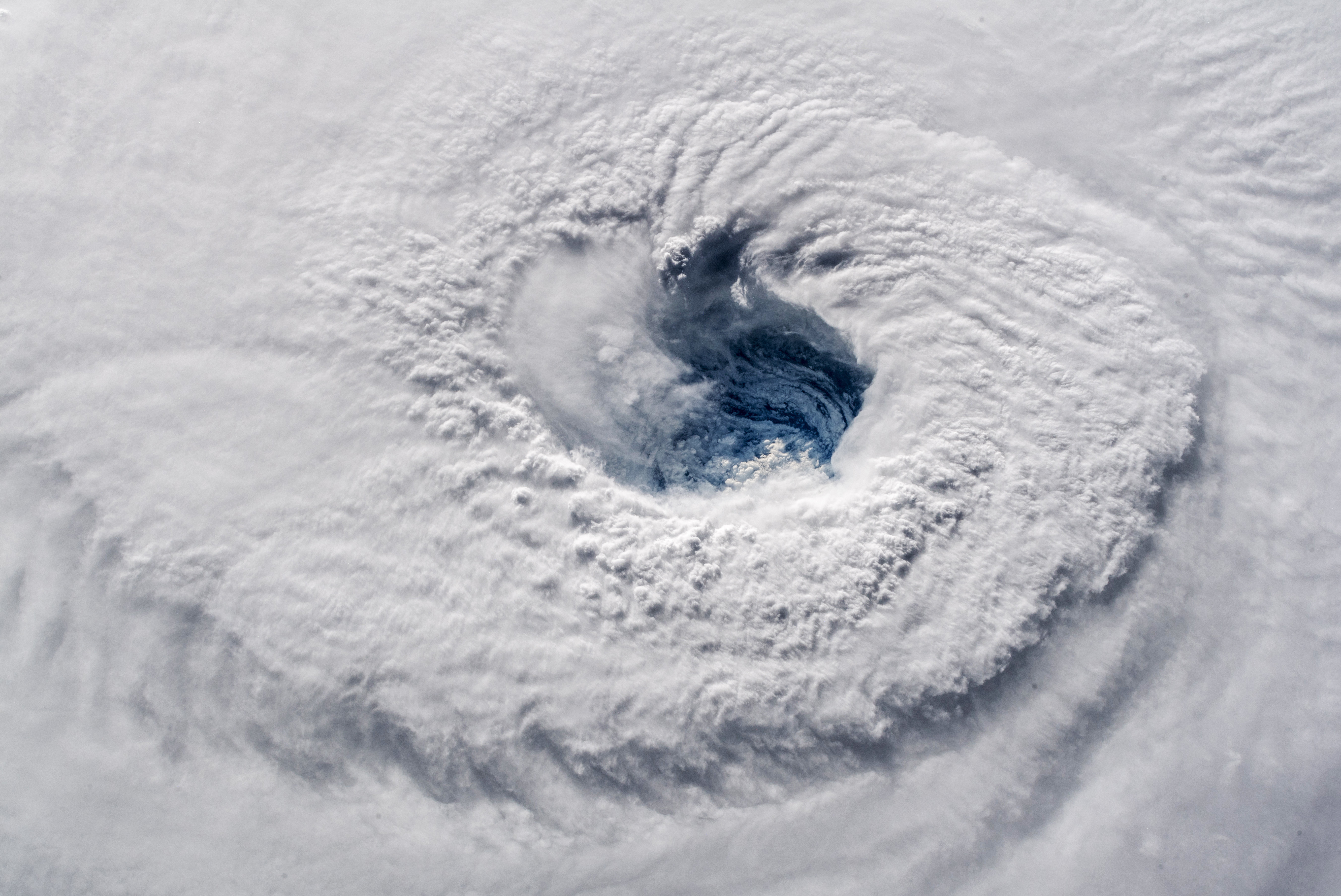 """In this Sept. 12, 2018 photo provided by NASA, Hurricane Florence churns over the Atlantic Ocean heading for the U.S. east coast as seen from the International Space Station. Astronaut Alexander Gerst, who shot the photo, tweeted: """"Ever stared down the gaping eye of a category 4 hurricane? It's chilling, even from space."""""""