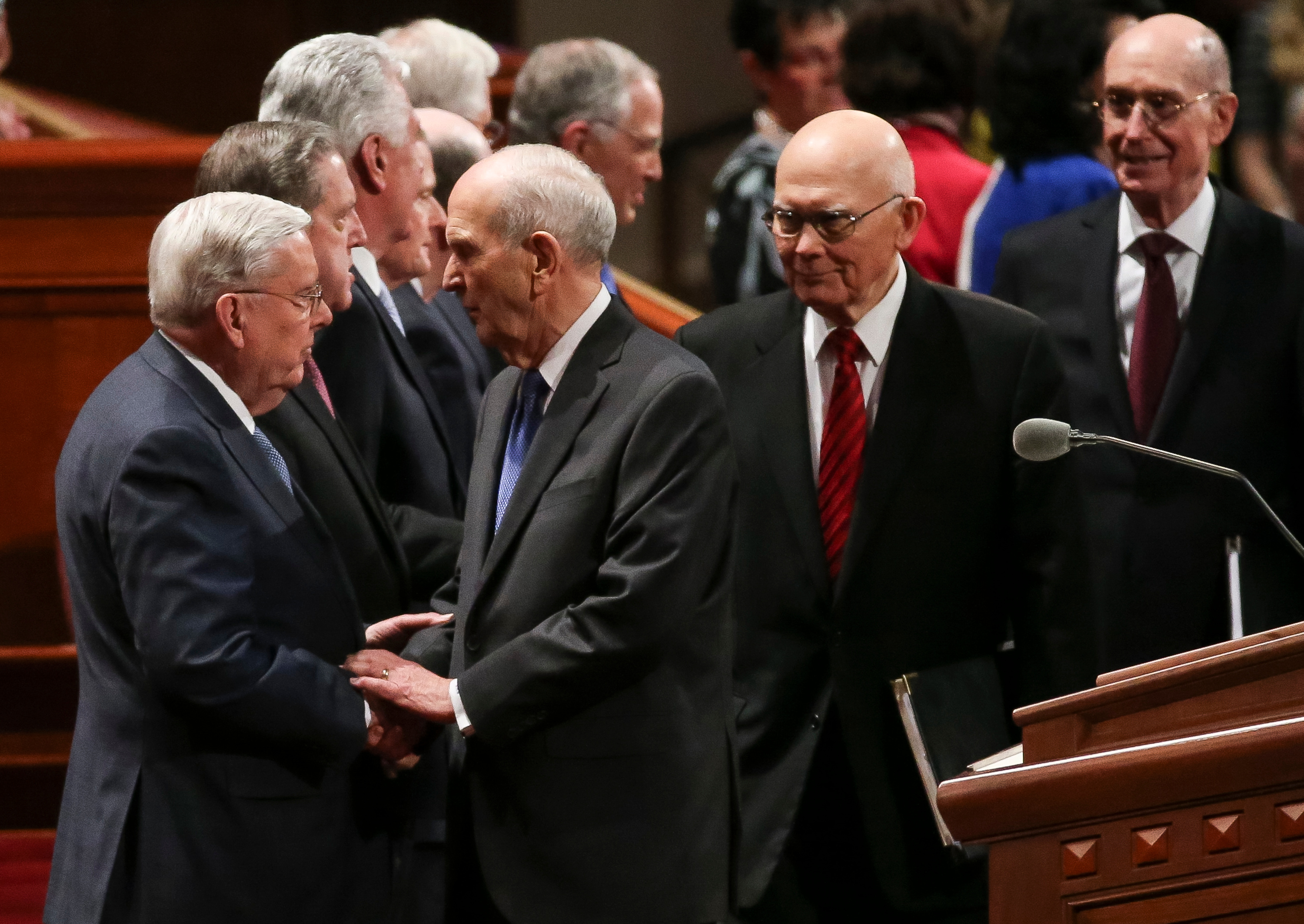 President M. Russell Ballard, Acting President of the Quorum of the Twelve Apostles, greets President Russell M. Nelson as he arrives with his counselors, President Dallin H. Oaks, first counselor in the First Presidency, and President Henry B. Eyring, second counselor in the First Presidency, at the start of the Saturday afternoon session of the 188th Annual General Conference of the LDS Church at the Conference Center in Salt Lake City on March 31, 2018.