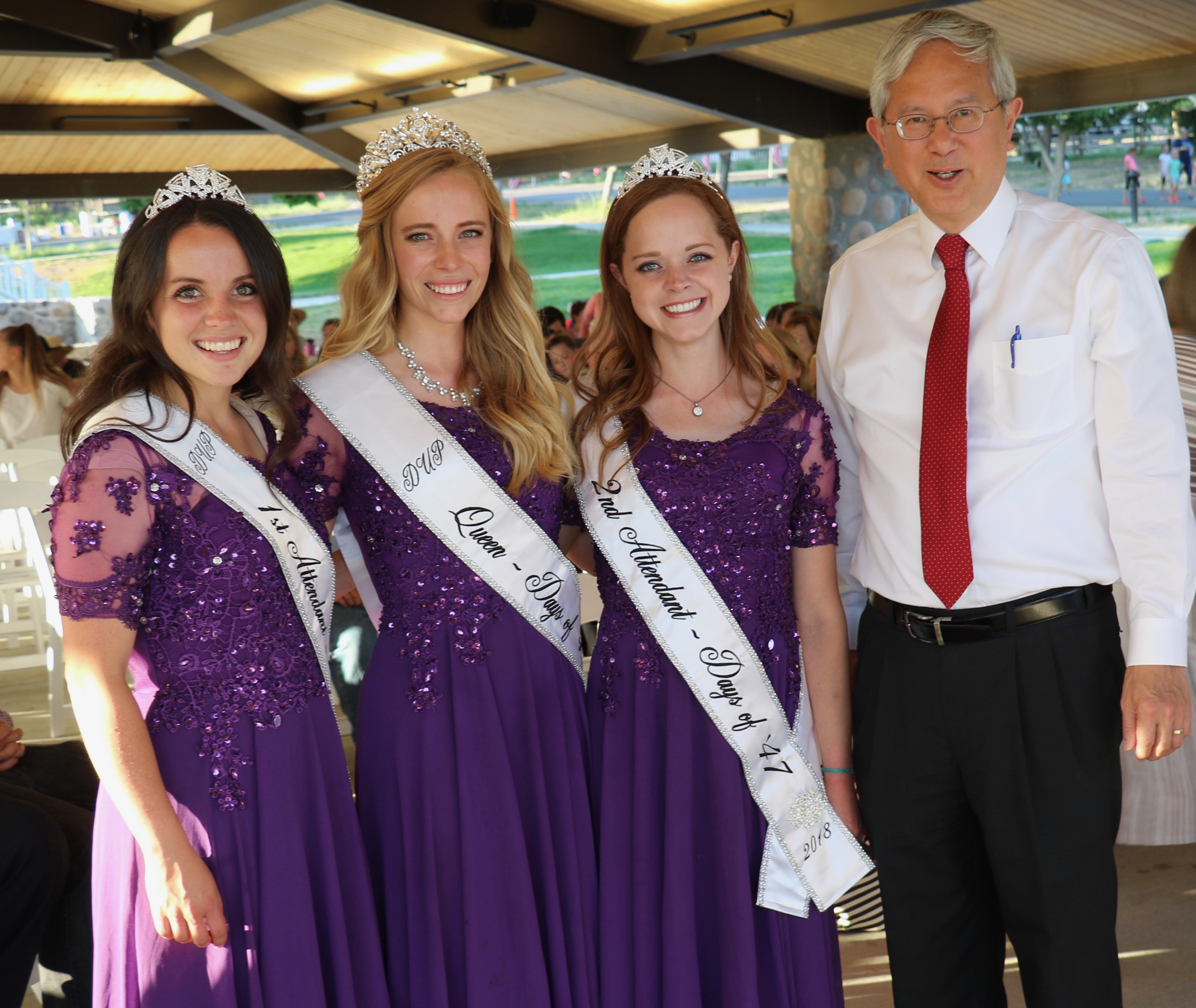 Elder Gerrit W. Gong was joined on the program of the July 16, 2018, pioneer-themed devotional by the 2018 Days of '47 Royalty. From left, Heidi Farley, first attendant; Lauren Bell, queen; and Rachel Roy, second attendant.