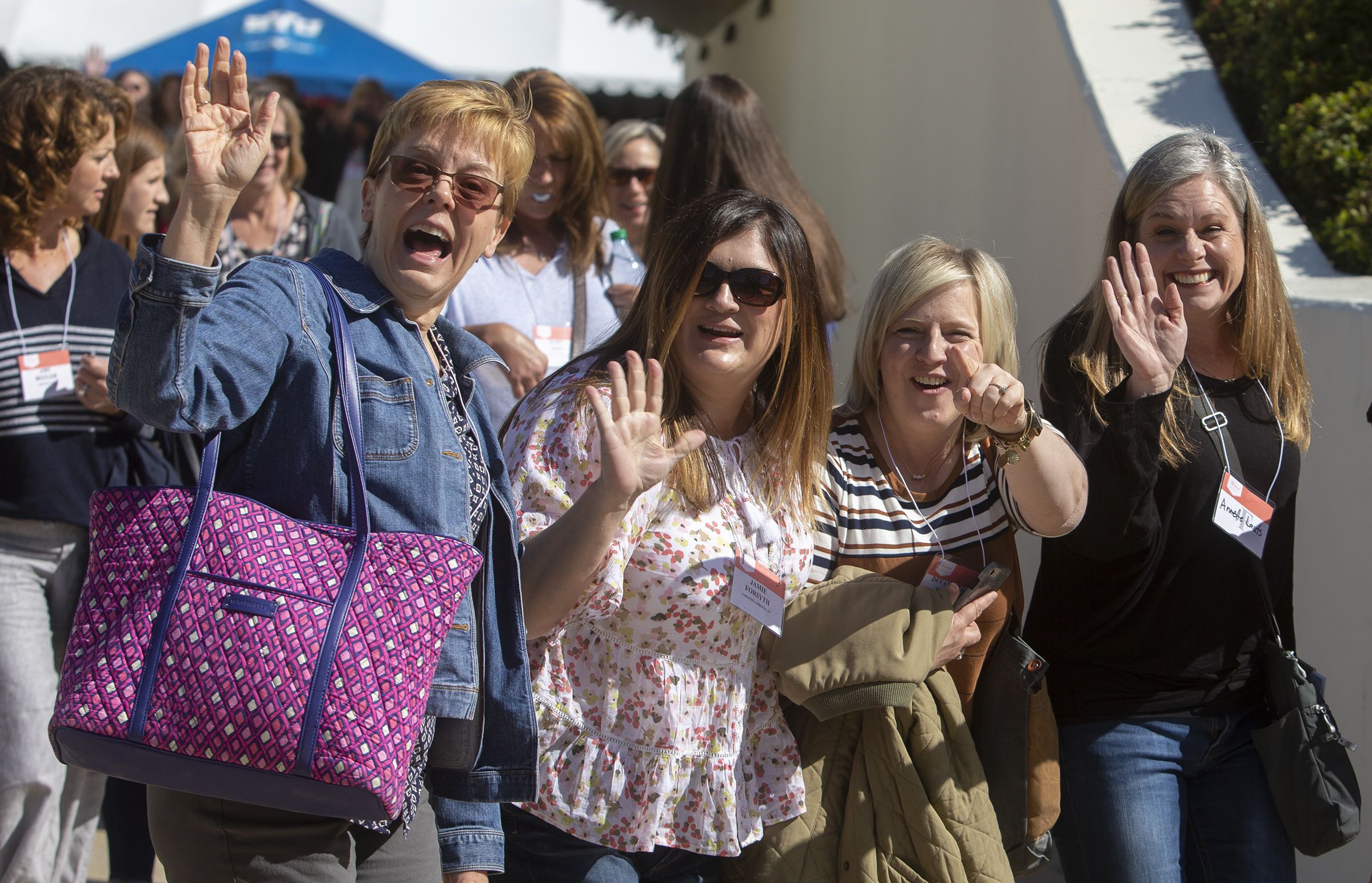Women wave as they move to other classes as they attend BYU Women's Conference at BYU in Provo, Utah, on Friday, May 3, 2019.