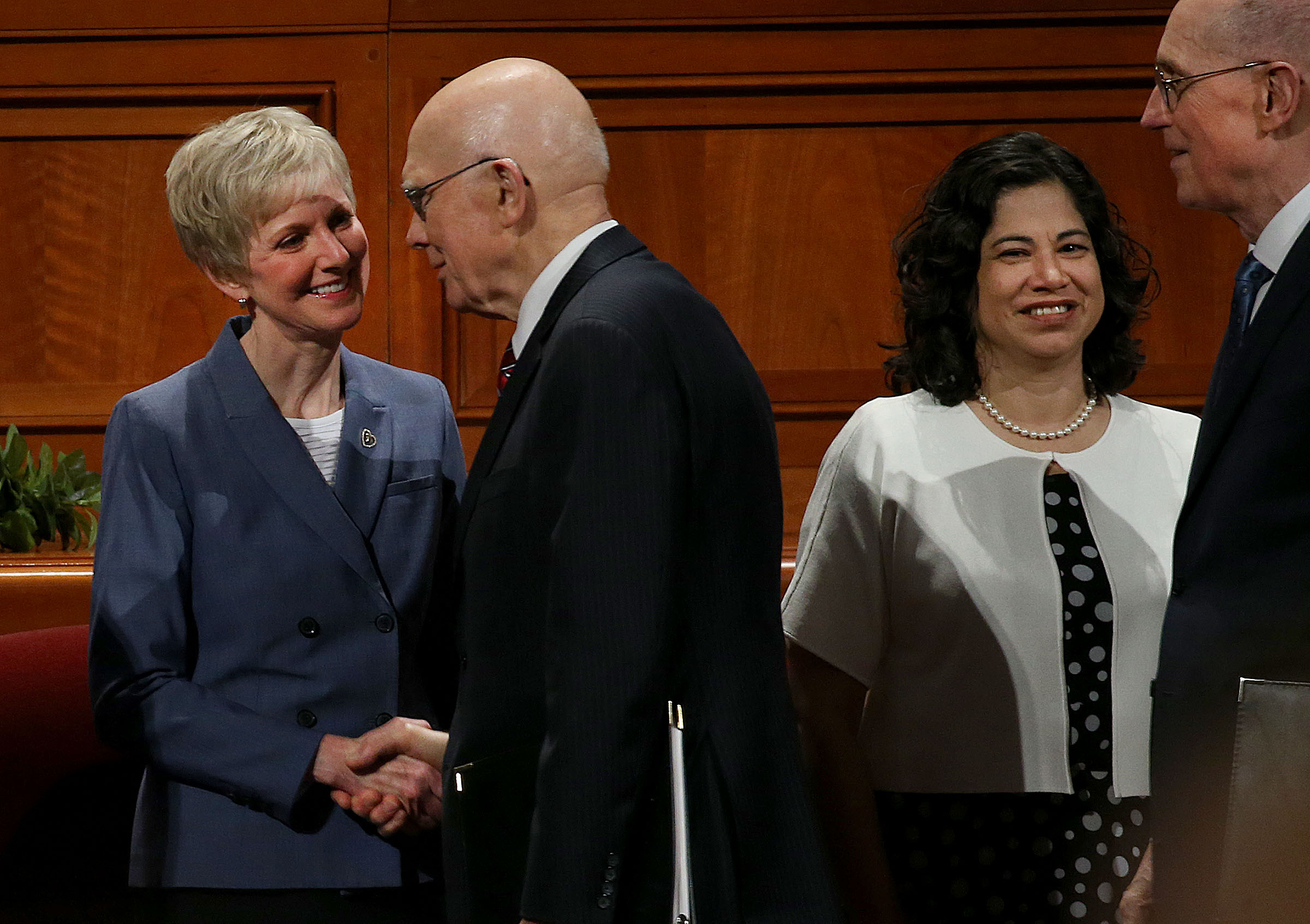 Sister Jean Bingham, left, Relief Society general president, greets President Dallin H. Oaks, first counselor in the First Presidency, speaks during the general women's session of the 188th Semiannual General Conference of The Church of Jesus Christ of Latter-day Saints held in the Conference Center in downtown Salt Lake City on Saturday, Oct. 6, 2018. At right is Sister Rayna Alburto, second counselor of the Relief Society general presidency and President Henry B. Eyring, second counselor in the First Presidency.