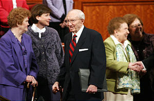 President Gordon B. Hinckley smiles as he enters the the Confernce Center for the Saturday morning session of the 176th annual General Conference for the Church of Jesus Christ of Latter-day Saints in Salt Lake City Saturday, April 1, 2006. Photo by Jason Olson