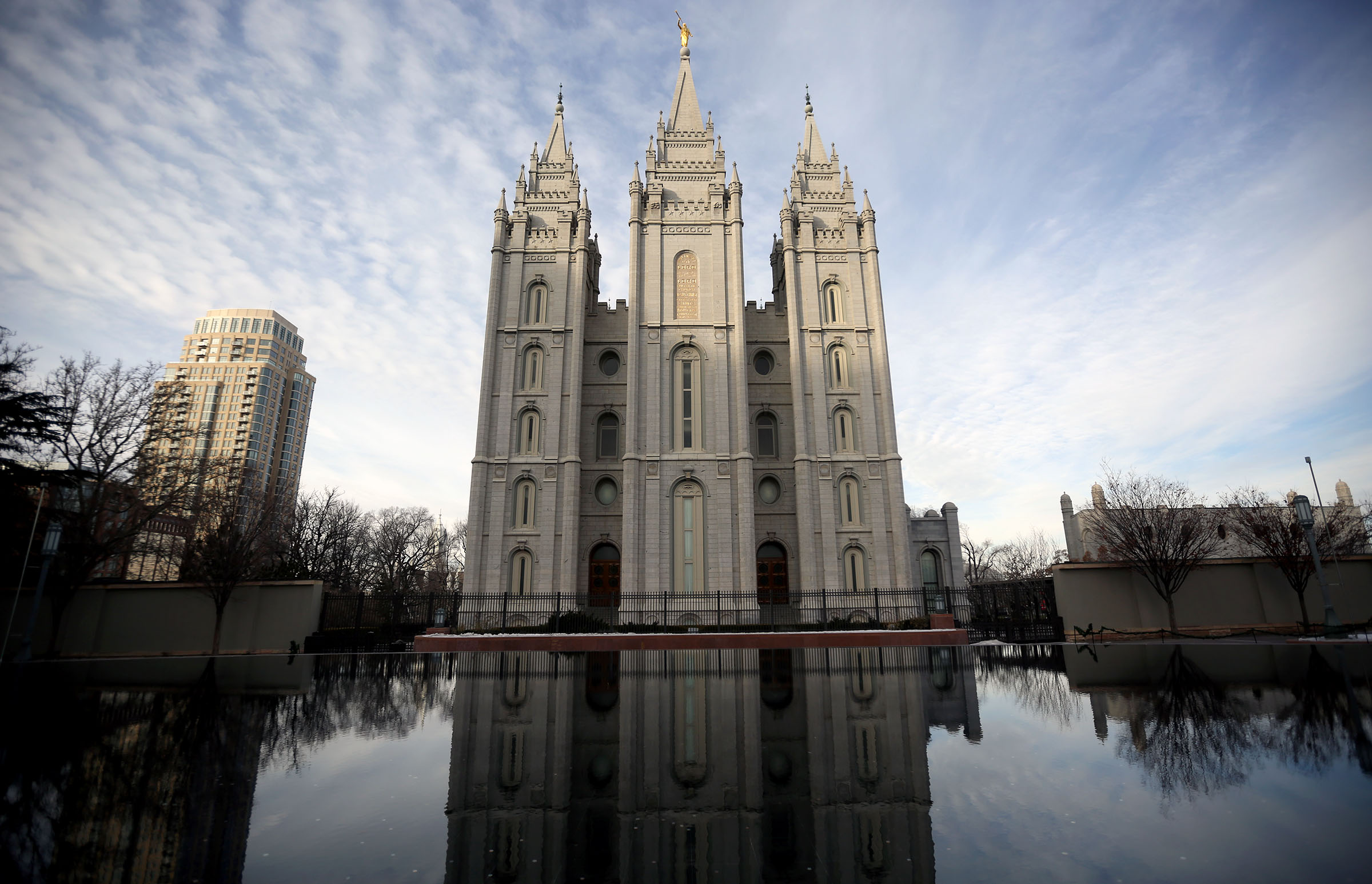 The Salt Lake Temple reflects in the reflection pool in Salt Lake City on Jan. 3, 2018.