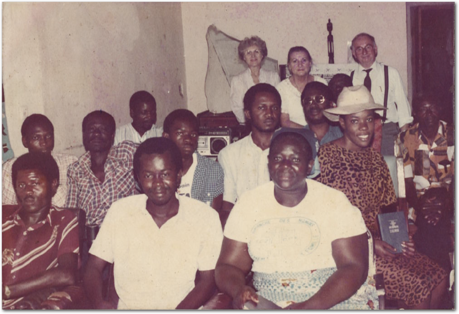 A group from Mucioko Banza's study group being taught by Church missionaries in 1986 in Kinshasa, Zaire, pose for a photo.