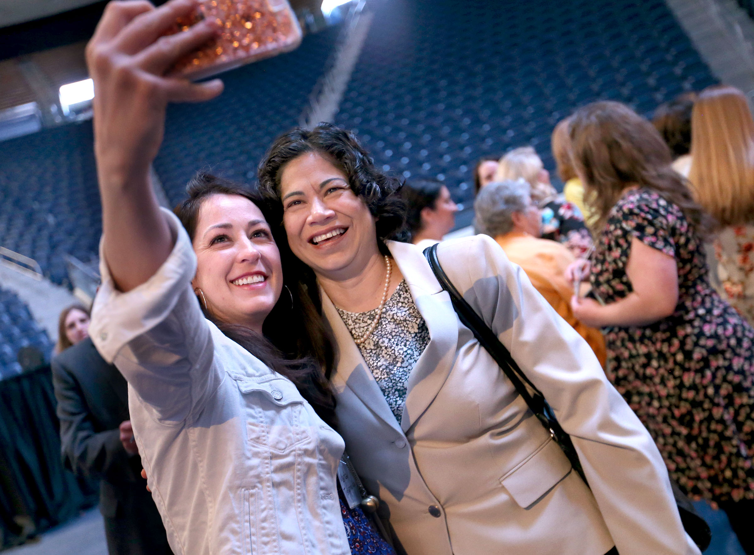 Maria Tedjamulia, left, takes a photograph with Reyna I. Aburto, Relief Society Presidency Second Counselor, after members of the Relief Society General Presidency spoke at the BYU Women's Conference in the Marriott Center at BYU in Provo on Friday, May 5, 2017.