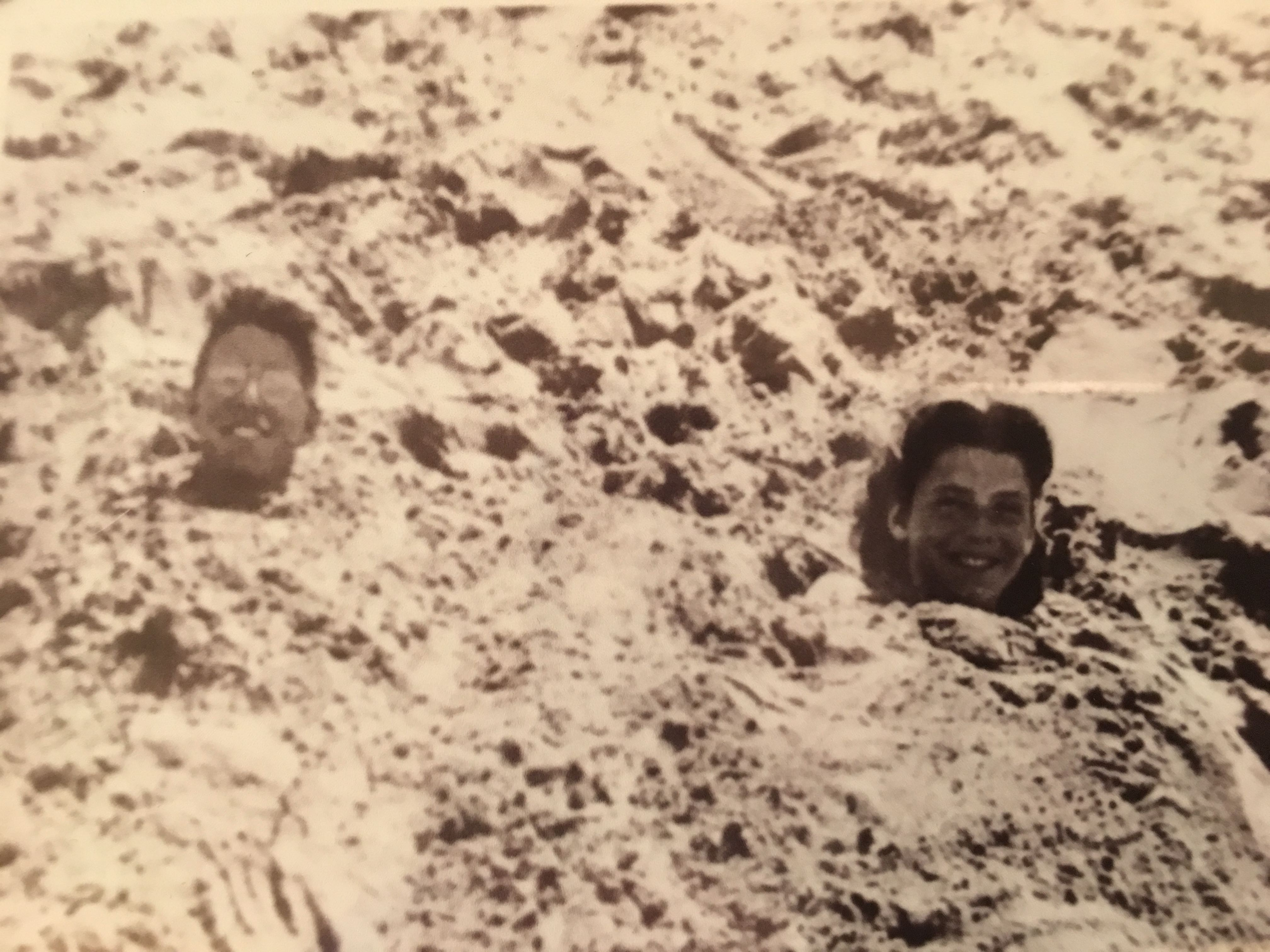 Shirley Anderson found this photo of her and Bud buried in the sand (around the time of their 8th grade year) as she prepared to move to Arkansas to marry Bud.