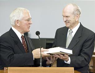 Elder Marlin K. Jensen presents Elder Russell M. Nelson a copy of the new volume.