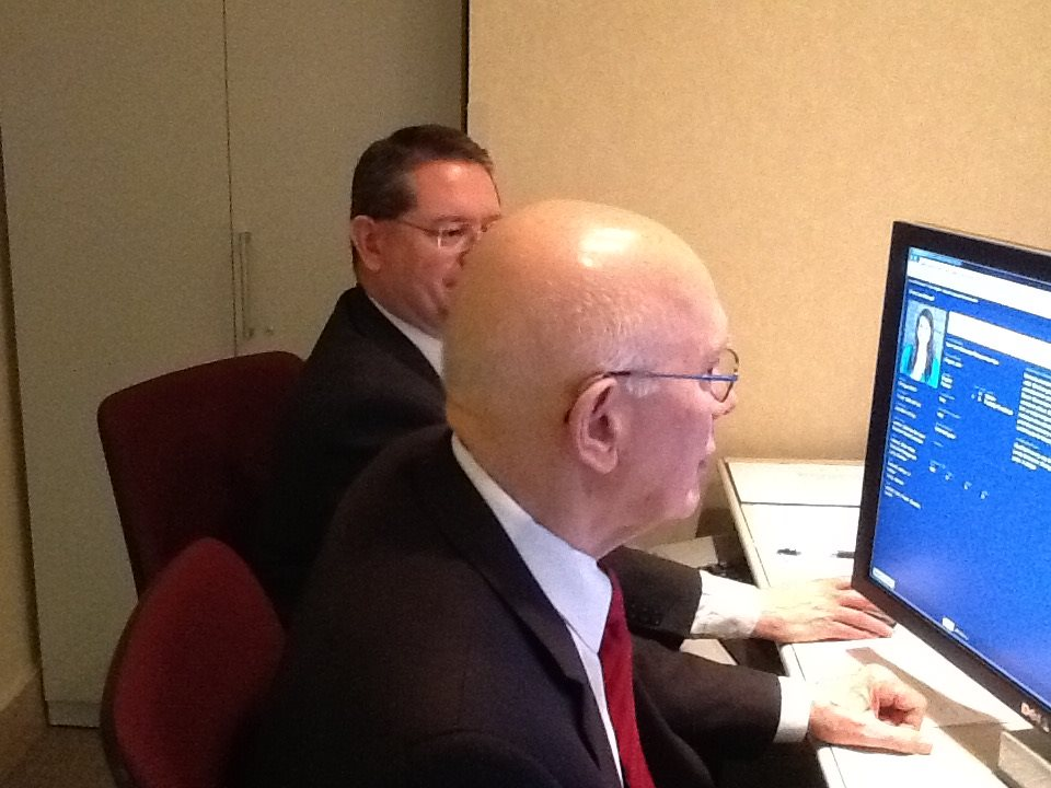 "In a May 27, 2015, Facebook post, then-Elder Dallin H. Oaks works with Dwayne Saviano at a missionary assignment meeting. ""I assigned 240, my share of the 1,047 (which includes young missionaries, senior couples, and senior sisters) whose papers were ready for assignment last week. We are assisted in this sacred experience by a member of the Missionary Department staff, who keeps records and manages the computer screens on which we view the essential information on elders and sisters and the needs (including languages) of our more than 400 missions in the world."""