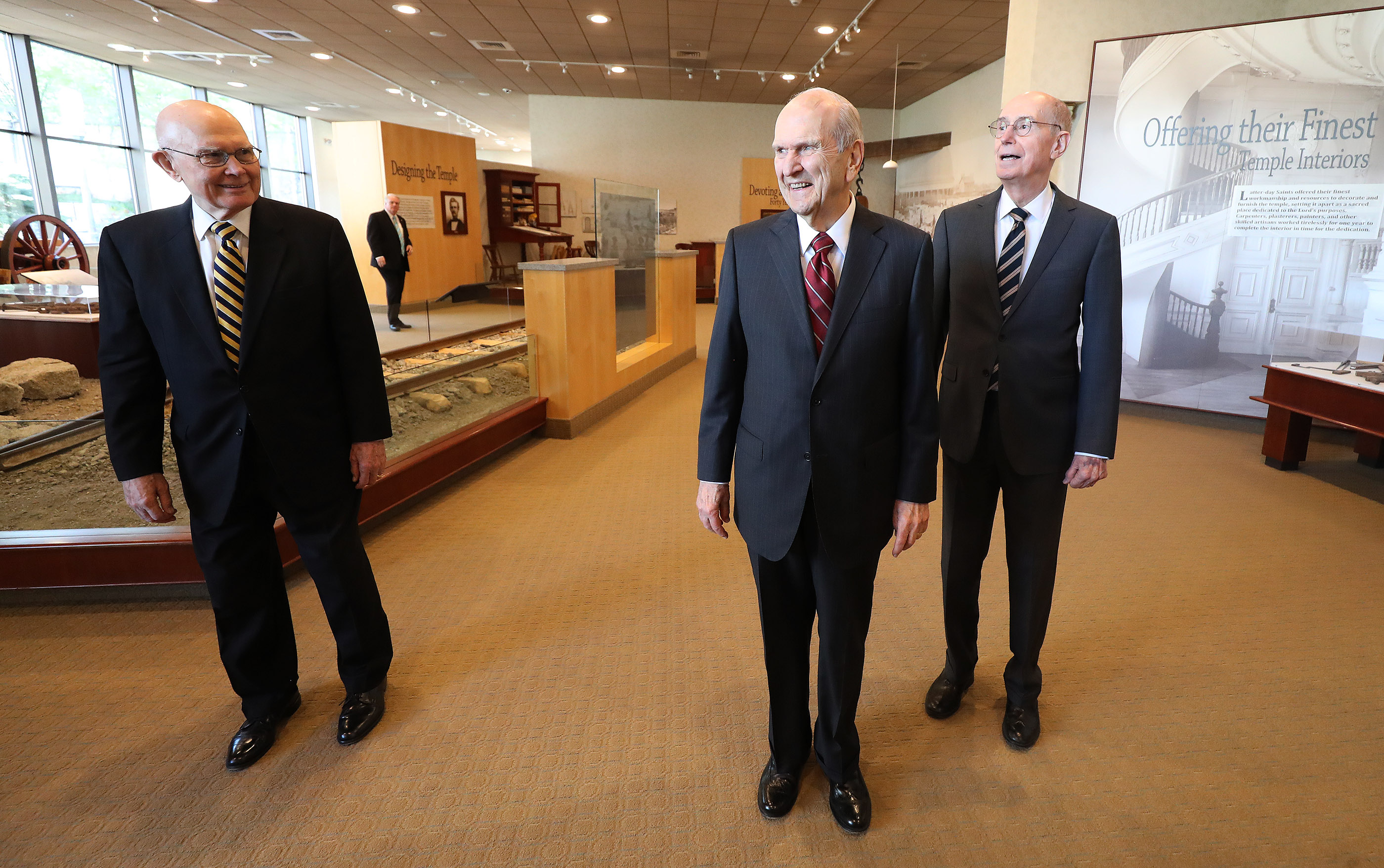 President Russell M. Nelson of The Church of Jesus Christ of Latter-day Saints, center, and his counselors, President Dallin H. Oaks, first counselor in the First Presidency, left, and President Henry B. Eyring, second counselor in the First Presidency, right, walk through the South visitors' center prior to a press conference in Salt Lake City on Friday, April 19, 2019.