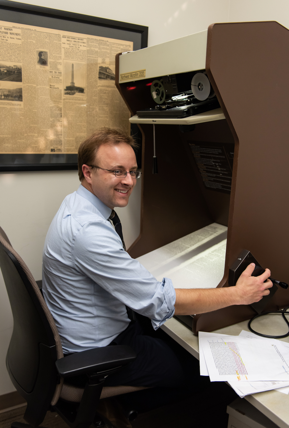 Historian J. Chase Kirkham uses the microfilm reader to research newspapers from the 1840s for a forthcoming volume of the Joseph Smith Papers.