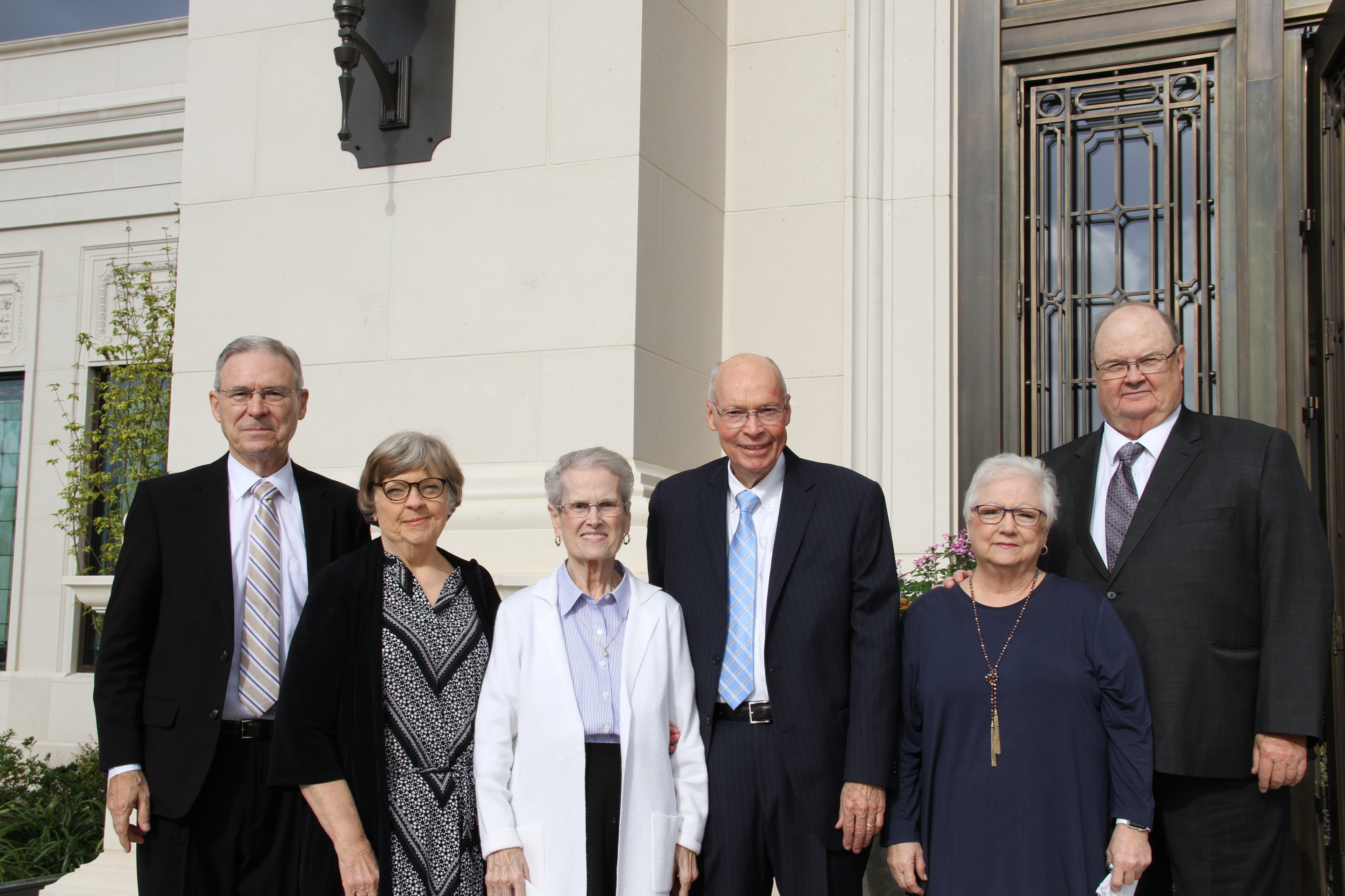 Left, Jim and Marlena Griffin, Elmer and Doris Black, and Evan and Lou Ann Nebeker, former temple presidents, pose outside the Memphis Tennessee Temple on May 5, 2019 prior to the rededication.