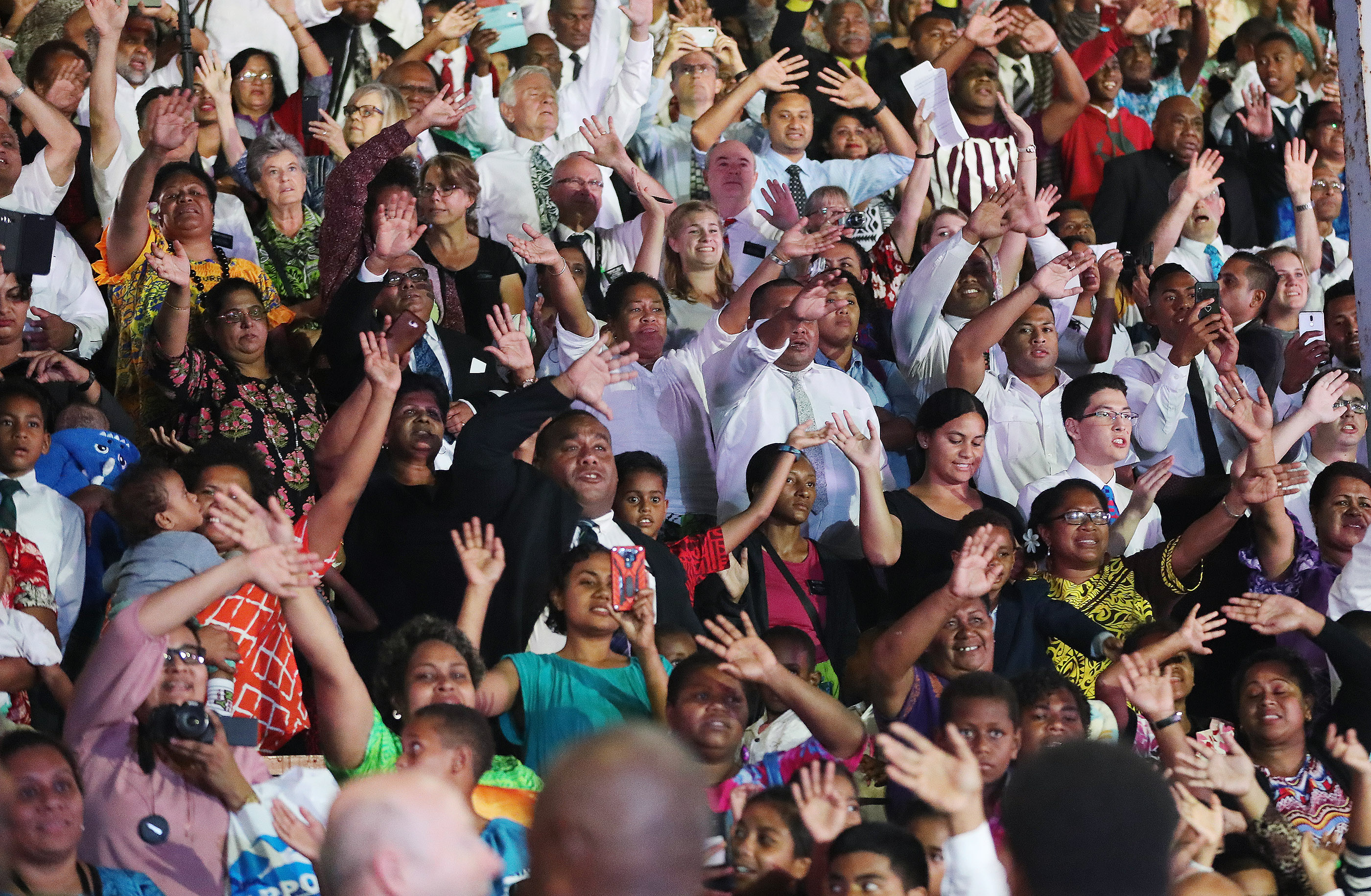 Attendees wave as President Russell M. Nelson of The Church of Jesus Christ of Latter-day Saints leaves after a devotional in Nausori, Fiji, on May 22, 2019.