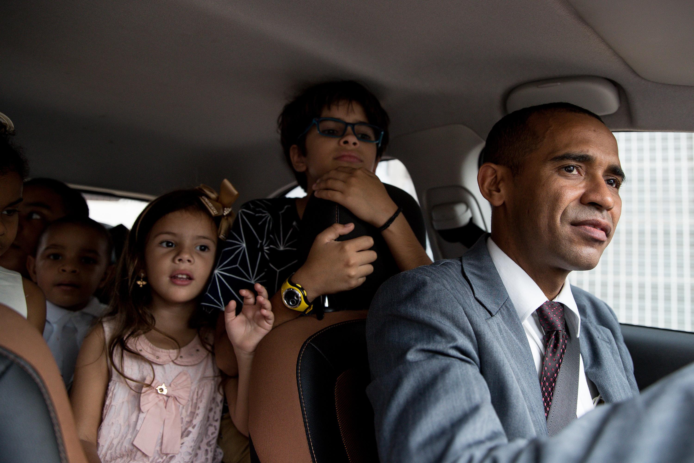 Edivaldo Brito, right, drives a car full of young family members to church in Cabo de Santo Agostinho, Pernambuco, Brazil, on Sunday, May 27, 2018.