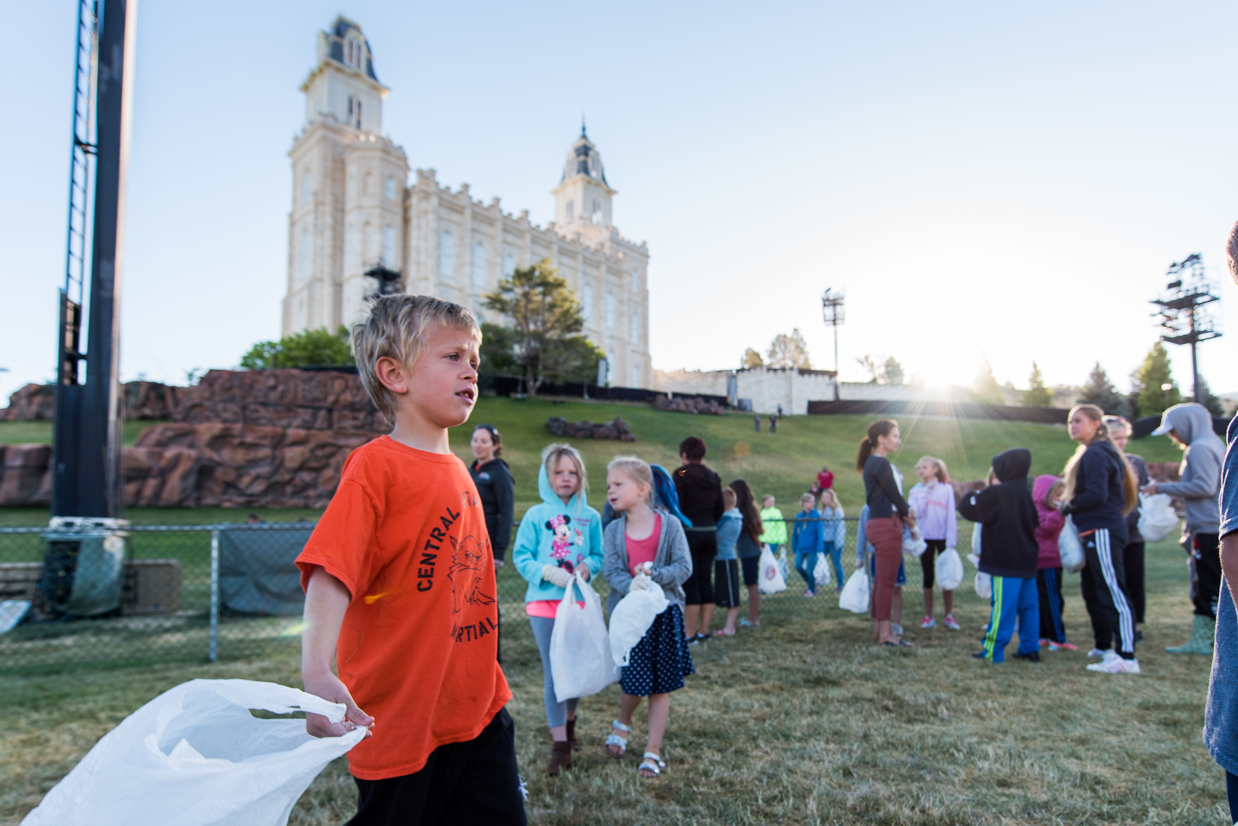 Children from around San Pete county, Utah come to the Manti Utah Temple grounds early on June 21 to clean up any leftover trash from the Mormon Miracle Pageant.